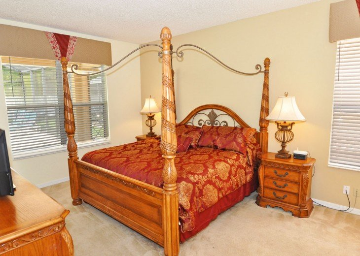 Master Suite 1 with king-size bed, TV & en-suite bathroom (ground floor)