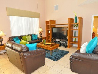 Family lounge with leather sofas and large flat screen TV