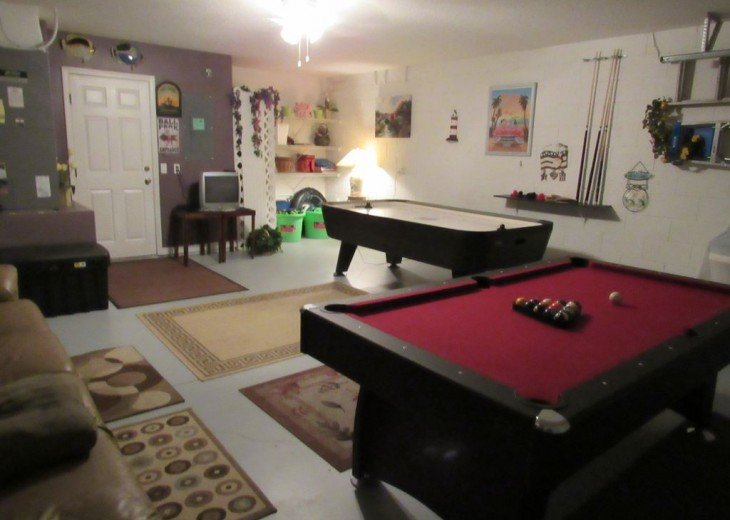 Playroom showing pool table/ping pong table and air hockey