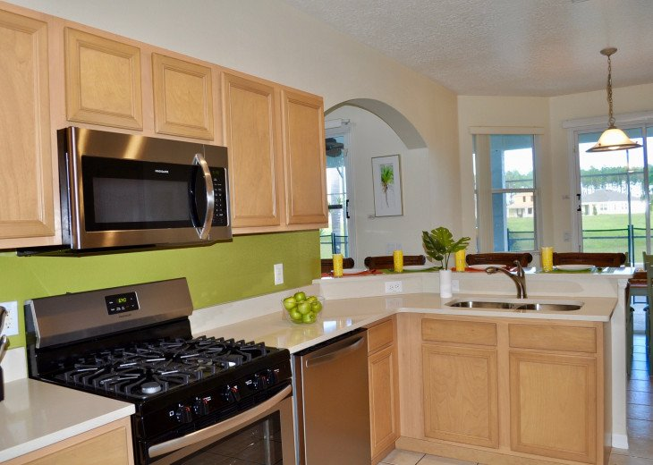 No rear neighbors! South Facing Pool and Disney Themed Bedrooms! Updated Kitchen #14