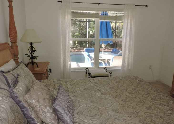 Master bedroom overlooks your own pool and conservation view