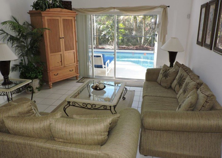 Your main sitting room overlooks your own pool and conservation area