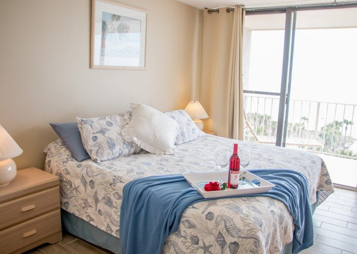 Ocean front master, King bed, attached bath, tile floors, ceiling fan, tv