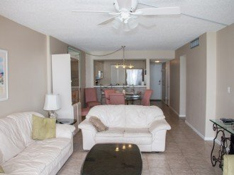 Nice size family/dining room, tile floor, leather couch/loveseat, 54 inch tv
