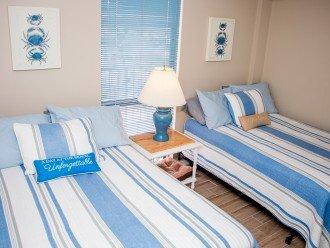 2nd bedroom, 2 full size beds, tv, tile floor, ceiling fan