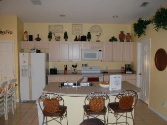 Kitchen and breakfast bar, table to your left and laundry room to the right.