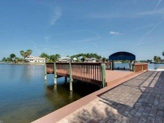 seawall and expansive deck plus boat lift with canopy