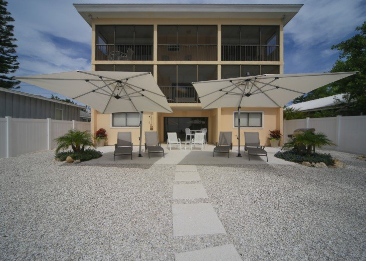 Patio deck for sunning, Gas BBQ, retractable umbrellas, tables and shower.