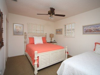 Bedroom #3 with a queen and a twin bed, big TV.