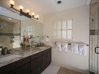 Master bathroom vanity and nice shower.