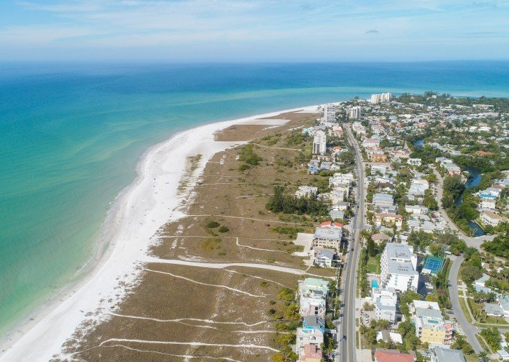 View looking north up Siesta Beach at high tide.