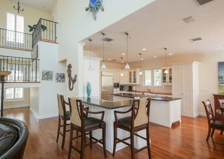 Entertain at kitchen bar to family room.