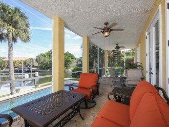 lanai off living area, door open to patio.