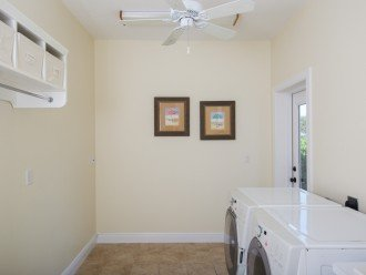 Large laundry room with door to back side lanai.