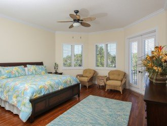 second bedroom on 2nd level, has a private bathroom with shower and patio access
