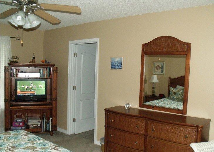 Master BR - large dresser, ceiling fan, ent. center (HDTV, DVD, books, games)
