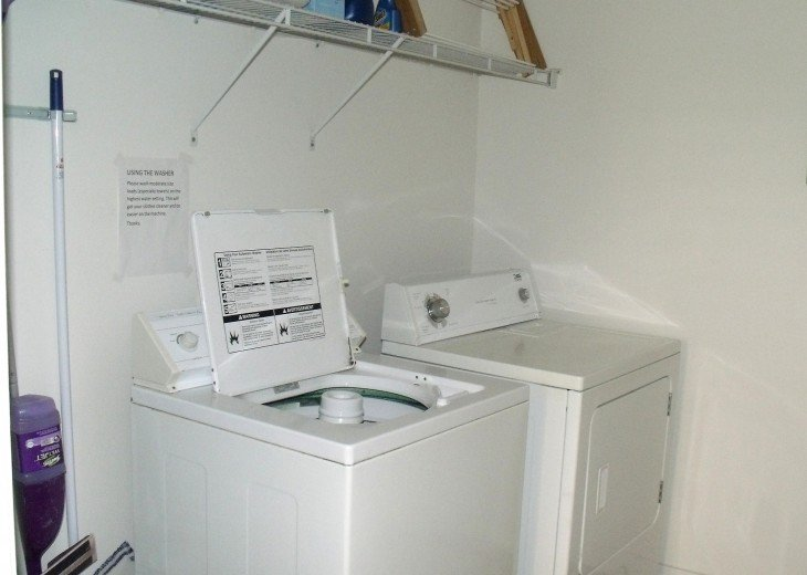 Laundry room with full size washer and dryer, laundry supplies provided