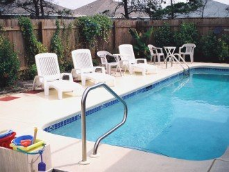 Large pool in fenced-in back yard, pool toys provided