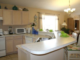 Kitchen w/ refrigerator/freezer, stove, dishwasher, microwave, small appliances