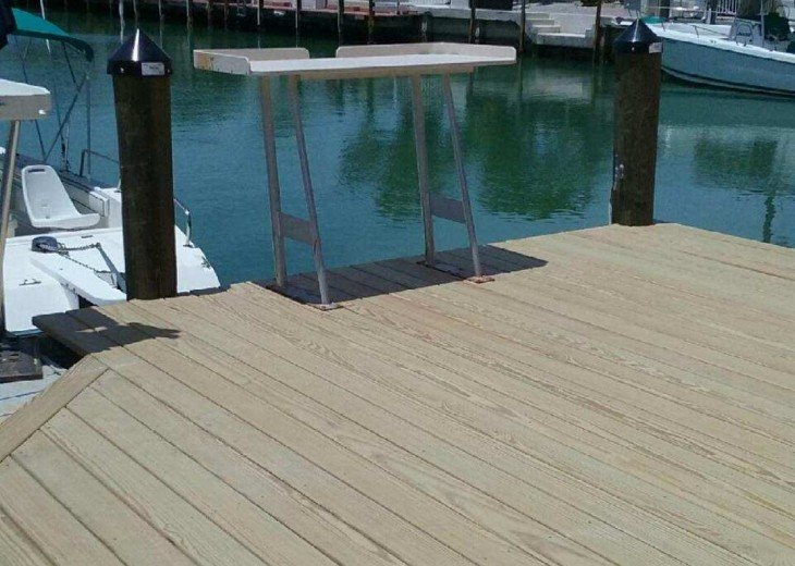 30' NEW wood dk. w steps down to boat, fish cleaning table, lights/hose (nip)