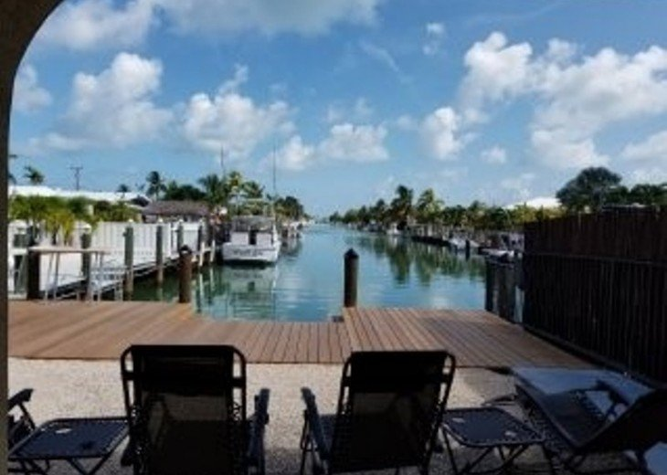 Beautiful, rare views down entire 10th/11th St. canal to Ocean+Gulf