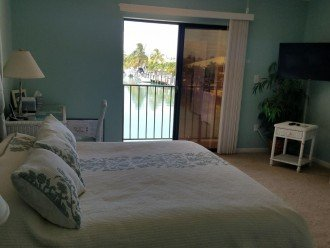 KING master bedroom, Desk/Chair, balcony views to end of canal, 40
