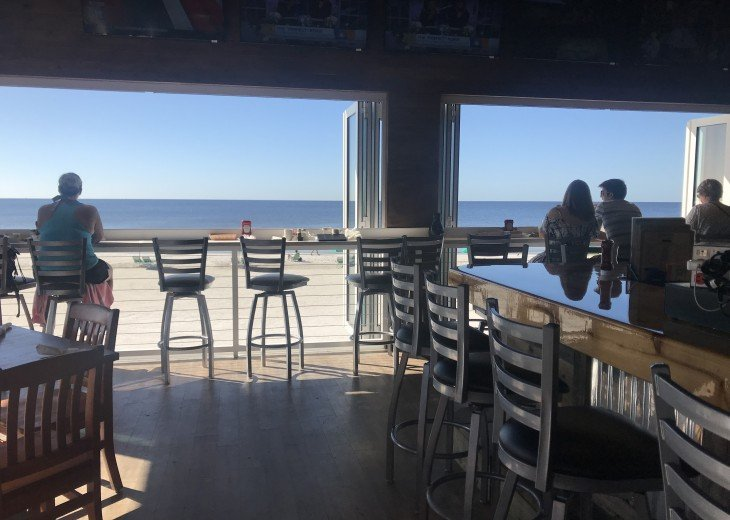 Enjoy the great views from the bars along the beach!