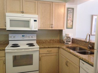 New appliances & granite counters with views of the beach from the kitchen.