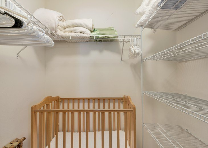Master walk-in closet stores folding cribs