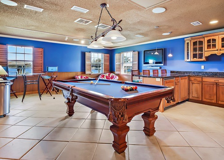 The Man Cave with flat screen, sub zero fridges and pool table