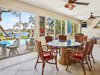 Pool side Florida Room and dining area with fridge, bar and ice maker