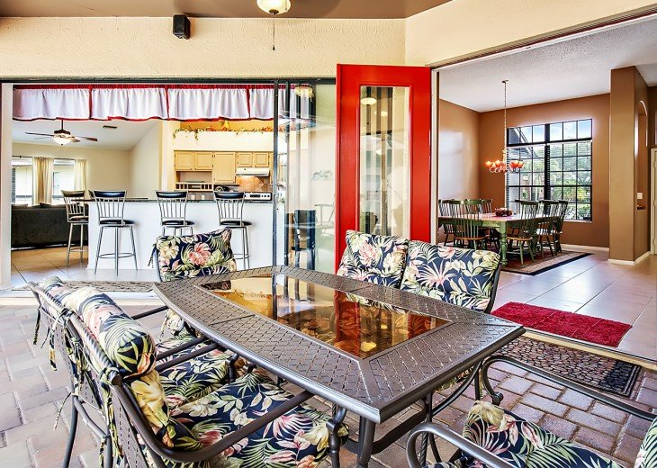 Sit out side and enjoy the covered lanai area with french doors and rolling slid