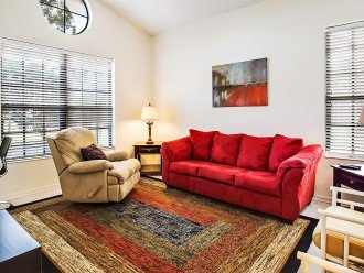 The front living room with pull out couch and seating area