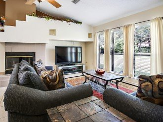 Comfortable living room for entertaining with large flat screen TV