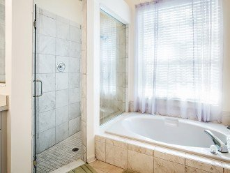 Recently renovated tiled walk in shower and large garden tub
