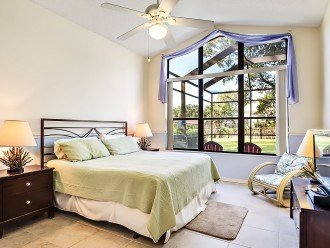 Master Bedroom by the pool with flat screen TV