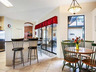 Centrally located kitchen stocked with all you need for cooking vacation sized m