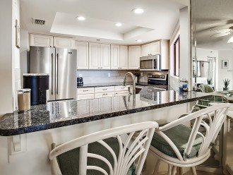 Brand new blue granite kitchen with stainless steel appliances and custom cabine