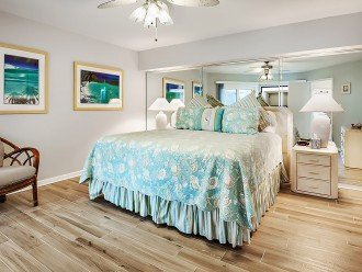 Plank tiled master bedroom with brand new Stearns and Foster matresses