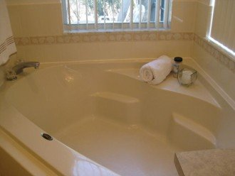 large soaker tub overlooking the pool