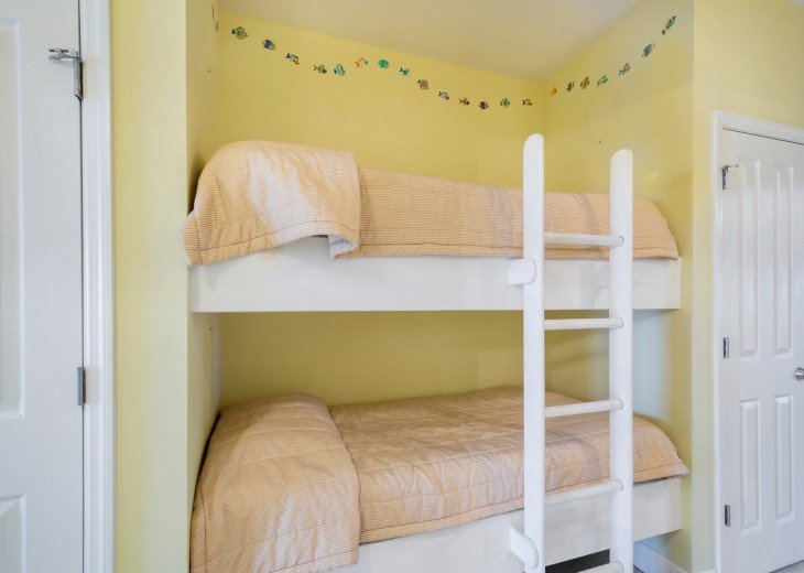 Bunks in hall across from full bathroom