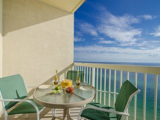 Enjoy dining on the balcony or relaxing on the zero-gravity chair