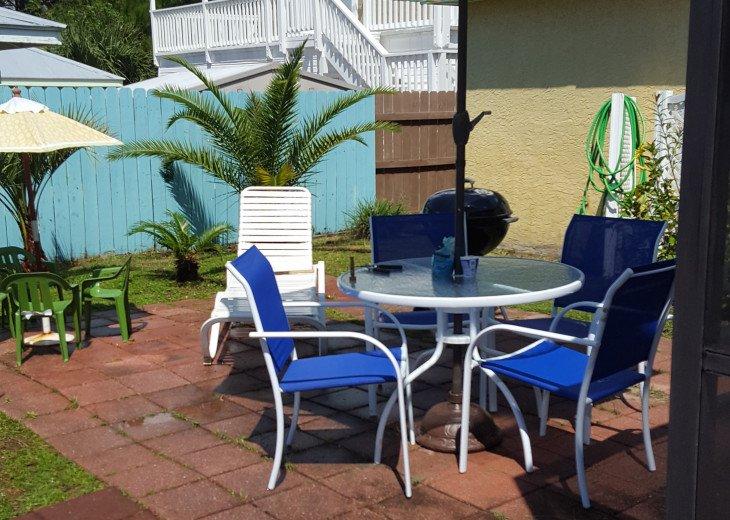 ptivate patio with table and umbrella, lounge chairs