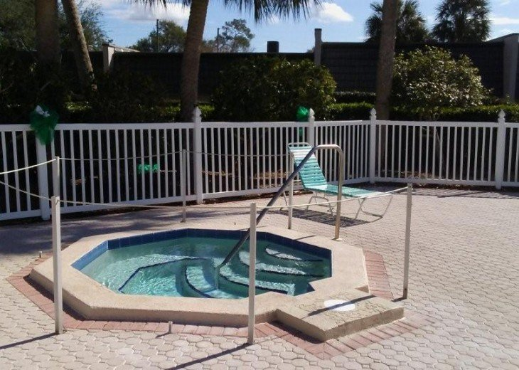 hot tub near condo unit and near pool