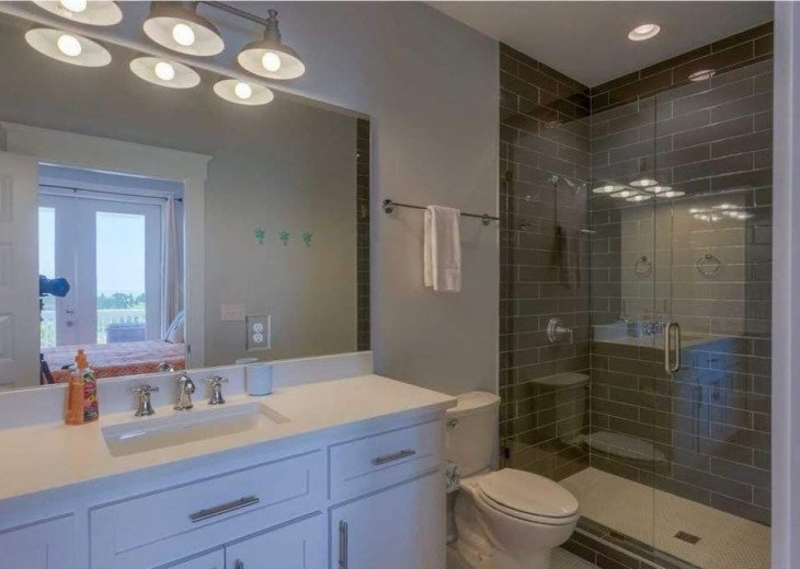 Modern bathrooms in this 2016 built home.