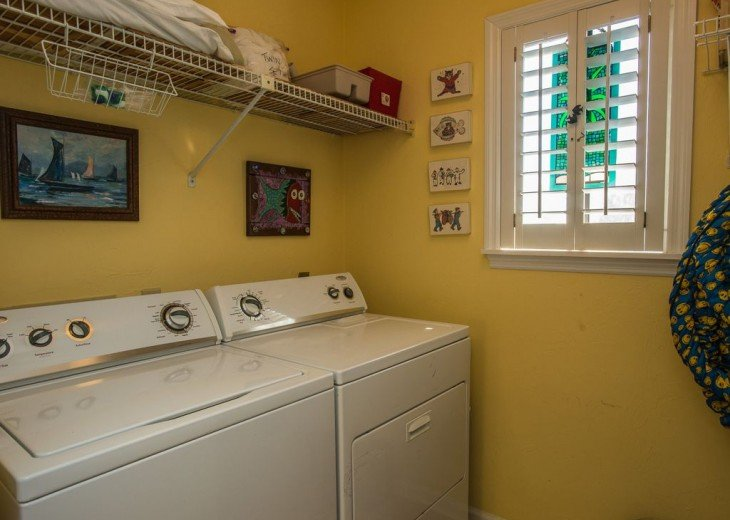 laundry room with maytag washer/dryer and central vacuum