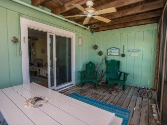 Screen porch with Hunter fan, Adirondack chairs, and picnic table