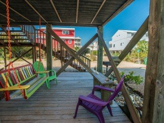 Swing and chairs on lower deck