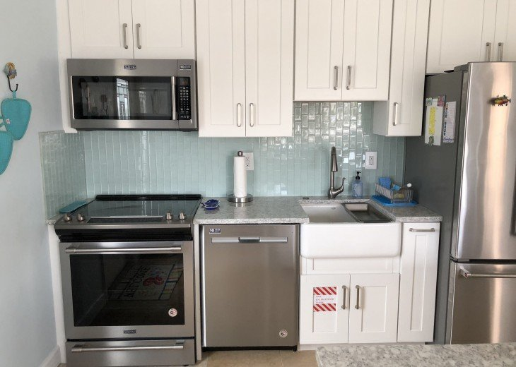 New Kitchen with Quartz countertops, Stainless appliance, Glass backsplash