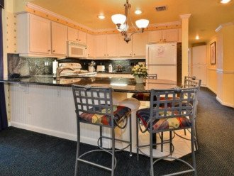 Full Kitchen with Granite counter-tops.